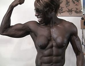Professional female bodybuilder Roxanne Edwards is naked in the gym, posing and showing you, in close-up, how amazingly ripped and vascular the ebony muscles of her abs, biceps, glutes, legs and pecs are.