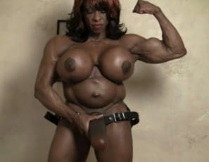 Female bodybuilder Yvette Bova got herself a monster ebony strap-on, and she's posing with it, showing off her vascular, muscular pecs, biceps, abs and legs, and telling you how she's going to make you choke on it and fuck you with her toy. She tells you: Take it like a man! Think you'd like her big dick?
