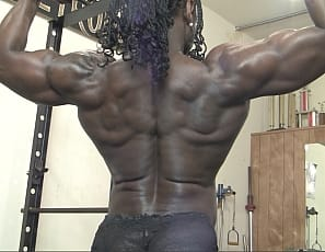 Rock hard ebony female bodybuilder Roxanne Edwards is n the SheMuscle gym again. This time she is working her biceps and showing how she builds them up - lifting weights and flexing and posing to show her vascular perfection.