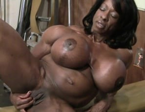 Female Bodybuilder Yvette Bova is working out and posing naked in the gym, showing off her big biceps and muscular abs, but she's getting so hot that she just has to squeeze her enormous pecs, stroke her big clit, masturbate and penetrate herself with her fingers. Watch her in close-up with her legs and glutes in the air, then enjoy the view as she pushes her ebony pussy into the camera and tells you to lick her big pink clit.