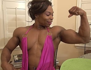 Female bodybuilder and muscle porn star Nadia poses for you to show you how ripped and vascular the tattooed ebony muscles of her pecs, legs, glutes, biceps, and abs are, then masturbates her big pink clit with a toy while you watch in close-up.