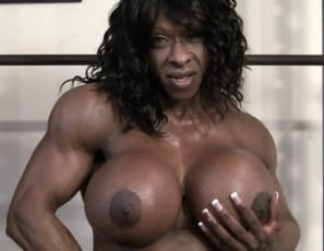 It's time for your virtual session in the gym with female bodybuilder Yvette Bova. She's getting pumped up with biceps curls and posing to show you her massive ebony pecs and muscled legs. After her workout, she lets you touch her muscles and watch her masturbate her big clit - in close-up.