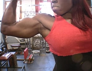 You're getting a virtual session with female bodybuilder and fem domme Mistress Treasure.  Enjoy the posing, worship the strong ebony muscles of her biceps, legs, and glutes, and see her visitor take verbal humiliation from her. Wouldn't you?