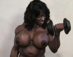 Vascular, ripped female bodybuilder Yvette Bova's working out and posing in the gym, showing off her gigantic pecs and muscular glutes, legs, biceps and abs and getting into some muscle porn fantasy, telling you to suck on her big ebony clit (It's big and juicy for ya, she says) as she masturbates. Enjoy all the juiciness in close-up.