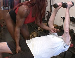 Female bodybuilder Mistress Treasure gives a virtual session in the gym, verbally humiliating her client, posing for him, smothering him with her ass, giving him CBT and making him worship the big ebony muscles of her legs, glutes and biceps.