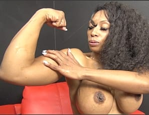 Fem domme and female bodybuilder Coco Crush is in panties and high-heeled shoes, working her pecs and oiling up the tattooed muscles of her ripped, vascular ebony biceps, abs, glutes and legs to get ready to wrestle. Watch her pose in close-up as she looks forward to muscle worship, scissoring, and verbal humiliation.