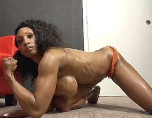 When you have a virtual session with female bodybuilder Coco Crush, she rubs oil all over the ebony muscles of her vascular biceps, tattooed pecs, ripped abs, and tight glutes and legs as she poses for you in panties and shows off her muscle control.