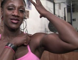 Female bodybuilder Mistress Empress is trash-talking while she works out in the gym and poses, making fun of you and showing off the gleaming ebony muscles of her powerful pecs, massive legs and chocolate biceps. But you'll have to take it – because you know she could crush you.