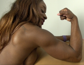 It's time for your virtual session with tattooed female bodybuilder Ashley Starr. She poses nude to show you how muscular her ebony pecs, legs, glutes, biceps and abs are, and how she'd spank you and examine you if she was your sexy muscle nurse.