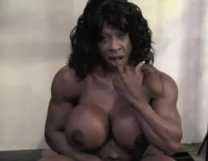 In the gym, female bodybuilder Yvette Bova poses, flexing her big biceps. She works her muscular legs and glutes on the , then works her big clit, masturbating it like the muscle porn star she is. Finally, she takes a big black cock and penetrates her pussy with the toy, then strokes her pecs and biceps with it. Watch all the bigness in close-up
