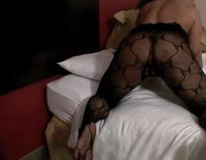 """Do you want me to take this off?"" bodybuilder Carmella Cureton asks in this video. She's wearing a black lace bodystocking, posing to show you her 17"" ebony biceps, her legs and her calves. If you like feet, you'll see a great closeup of her soles after she removes her shiny high-heeled boots. See if you can spot the hole in the bodystocking."