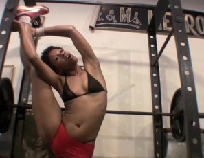 Super-flexible Melanie finds new ways to use the SheMuscle power rack, and can't resist stroking her smooth ebony self as she stretches in this video. She can do splits in every direction, and her slinky moves will get you as hot as they seem to get her.