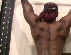 Pay close attention, bodybuilder Mistress Treasure orders, as she does topless chin-ups in the SheMuscle gym in this video, bending over to show off her gorgeous ebony glutes and legs. You know you want it, she taunts. You're just too weak to come and get it.