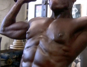 If you like muscles enormous and ebony, you're going to want to watch bodybuilder Roxanne Edwards do her shoulder workout at the SheMuscle® gym, naked except for tiny black panties. Every inch of her is chiseled and vascular, from her eye-popping abs to her massive legs, pecs, biceps and glutes. And those shoulders? Get too close and you'll need one to cry on.