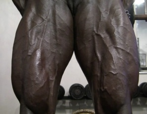 "In the gym, bodybuilder Roxanne Edwards  takes off the panties that say ""Yes Please"" and poses naked to show off the incredible vascularity popping out of her oiled ebony skin. Her pecs, legs, glutes, calves, biceps and abs ripple and glow. It's enough to make you say ""Yes, please."""
